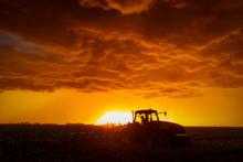 Farm Equipment Against A Storm...