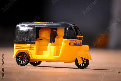 Fototapeta Indian Auto Rickshaw ,Yellow and black auto rickshaw toy,beautiful view of india