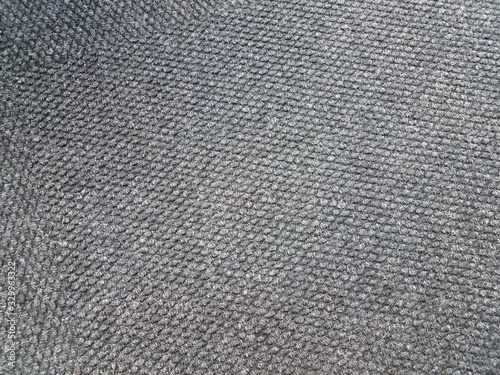 black and white carpet or rug on floor or background