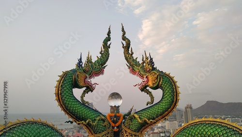 CHONBURI - THAILAND - February 29 , 2020 : Dragon statue in the temple on the mountain and views of the city of Sriracha.