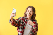 Young Woman Taking Selfie On C...