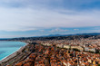 Panorama of the old town of Nice, France, the Mediterranean Sea shore and turquoise water, and the distant Alps mountains (Provence / French Riviera / Côte d'Azur)