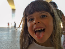 Portrait Of Cute Girl Sticking Out Tongue