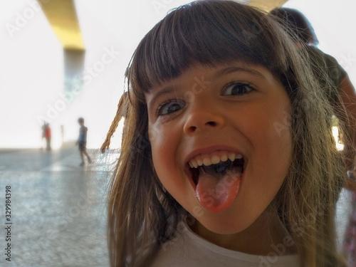 Obraz Portrait Of Cute Girl Sticking Out Tongue - fototapety do salonu
