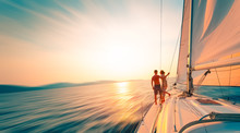 Young Couple Enjoys Sailing In...