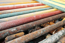 Colorful Metal Support Pipes Stack. Metal Tubes Used In Building Industry.