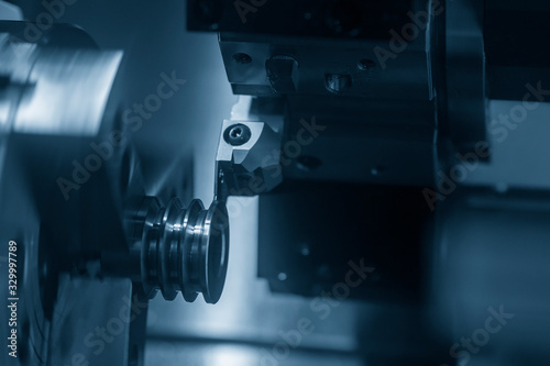 The CNC lathe machine  groove cutting the pulley parts by cutting tool Wallpaper Mural