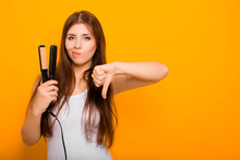 A Young Woman Straightens Her ...