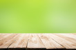 canvas print picture - Wooden surface on blurred green background.