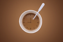 Cup Of Coffee With Clock On Br...