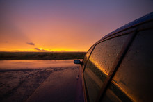 Sunset Rain. View Next To A Ca...