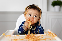 Cute Baby In High Chair Eating...