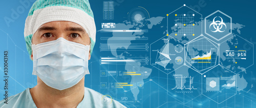 Fotomural medicine and pandemic concept - surgeon in protective mask over virtual projecti