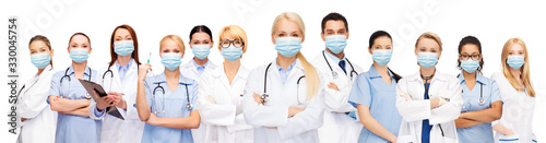 Fotografía health, medicine and pandemic concept - doctors and nurses wearing protective me
