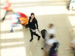 High Angle Portrait Of Young Woman With Luggage On Walkway