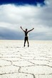 Full Length Of Man With Arms Outstretched At Salar De Uyuni Against Sky