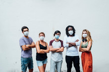Group Of Five People With Mask In The Street