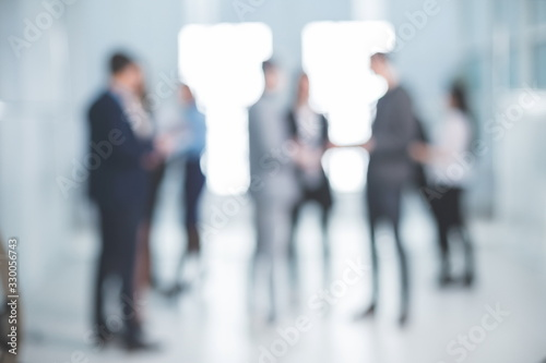 Fototapeta background image of a group of corporate employees in the office lobby obraz