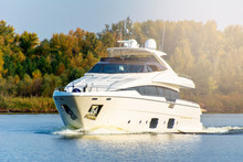White Luxury Yacht In Motion O...