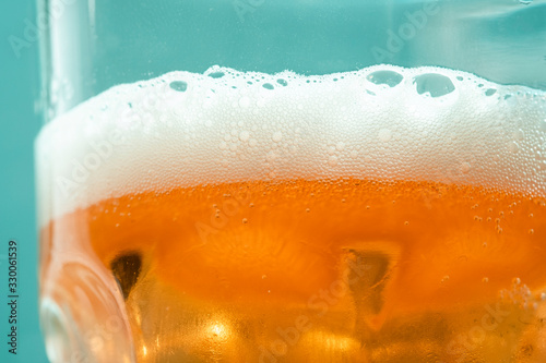 Close Up Glass Babble Lager Beer Blue background Canvas Print