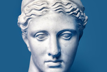 Marble Head Of Young Woman, Ancient Greek Goddess Bust Isolated On Pink Background. Gypsum Copy Of A Statue Diana Head