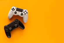 Stock Photo Of Two Gamepads On A Yellow Background And Copy Space