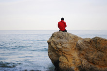 One Guy Sits On A Rock By The ...