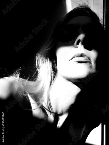 Fototapety, obrazy: Headshot Of Woman In Shadows