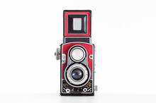 Old Vintage Medium Square Format Twin Lens Reflex Camera Wrapped In Red Leatherette Front View Isolated On White Background
