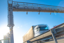 Truck Passing Through A Toll Gate On A Highway Toll Roads