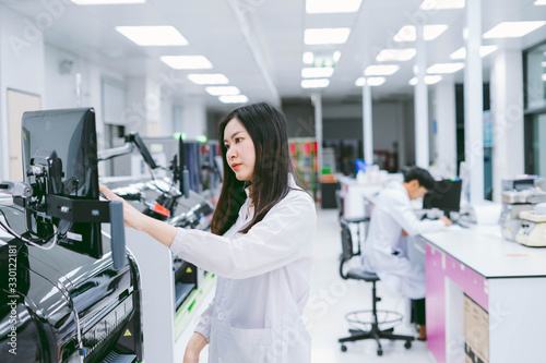 young female scientist working with automation blood analyzer in medical laborat Canvas Print
