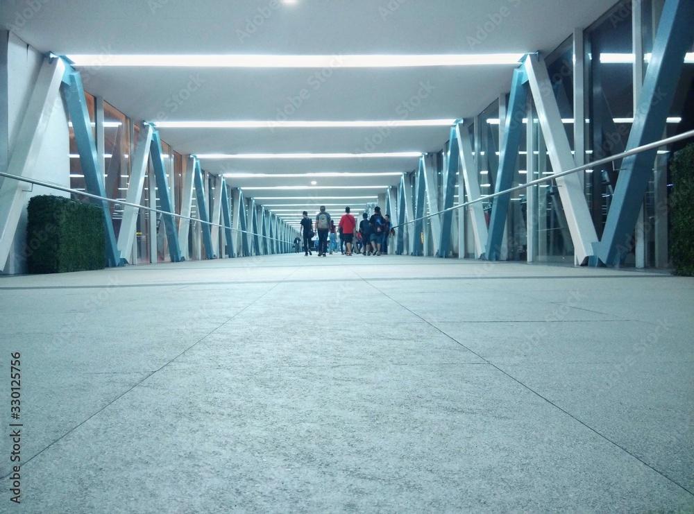Fotografie, Obraz People In Corridor Of Modern Building