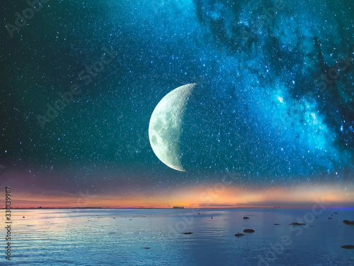 Starry night  moon on blue  sky at sea, sunset at  summer season , sea dark blue water  reflection ,moonlight blue lilac pink   background nature,tropical island , weather ,holiday travel to vacation