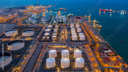 Photo Aerial view oil and gas terminal storage tank farm,Tank farm storage chemical petroleum petrochemical refinery product, Business commercial trade fuel and energy transport by tanker vessel
