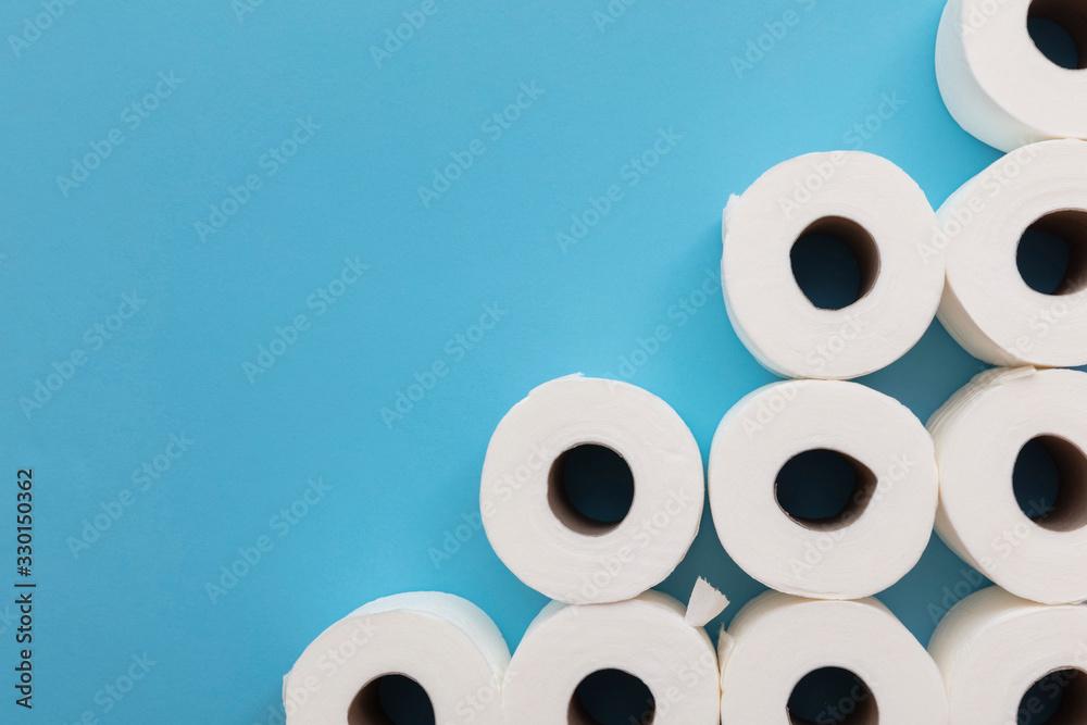 Fototapeta Toilet paper roll background. overhead flat lay.