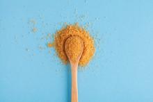 Brown Sugar In Wooden Spoon On...