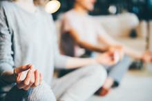 Calm Couple In Pajamas Meditat...