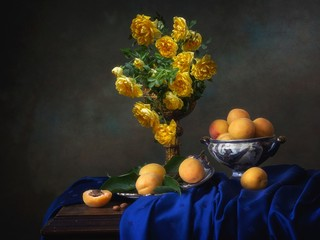 Still life with yellow roses and apricots