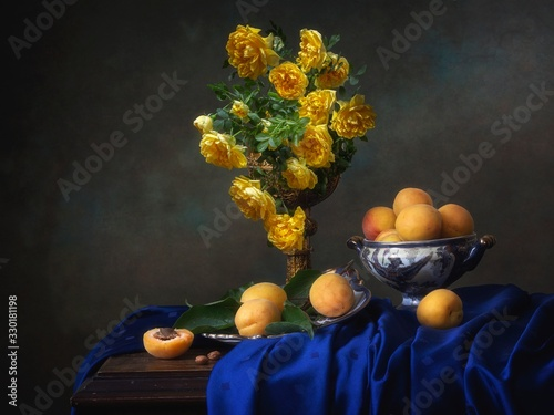 Fototapeta Still life with yellow roses and apricots obraz