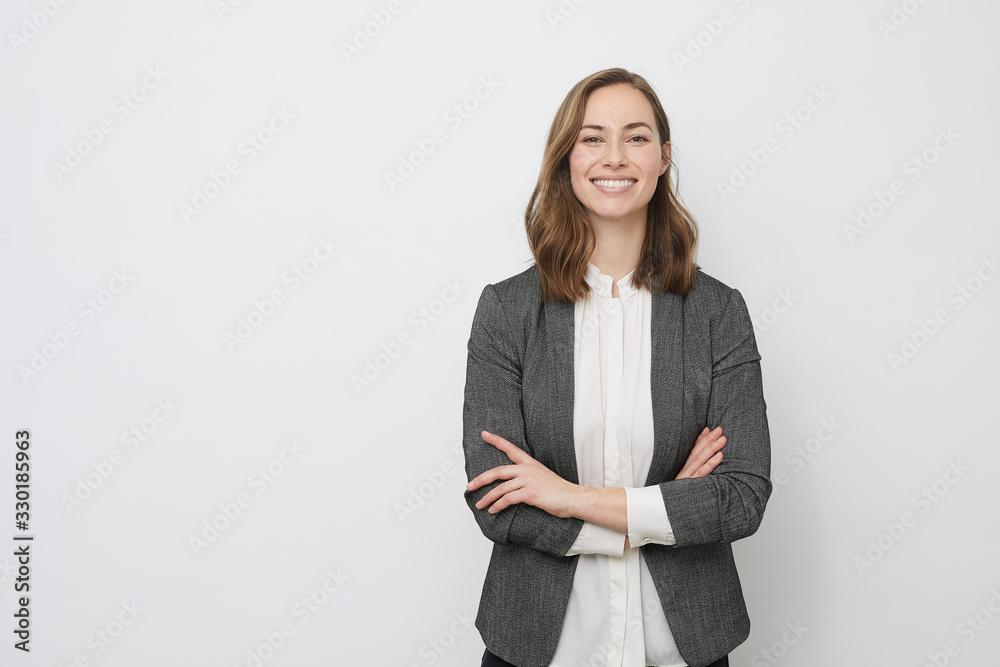 Fototapeta Confident businesswoman smiling at the camera