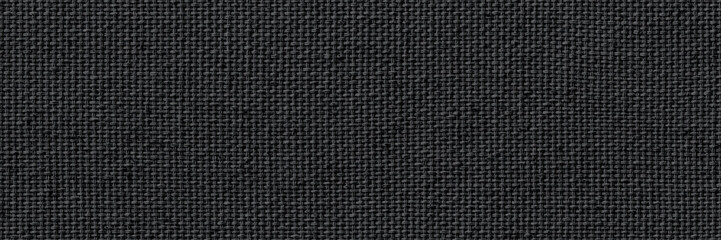 Closeup texture of natural weave cloth in dark gray or black color. Fabric texture of natural cotton or linen textile material. Wide and long panoramic background.
