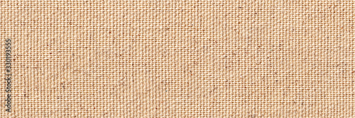 Fototapeta Blank, uncoated canvas or scrim for painting. Long and wide panoramic banner background from rough linen beige cloth or burlap. obraz