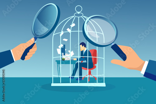 Tela Vector of a businessman working at desk trapped inside birdcage being observed b