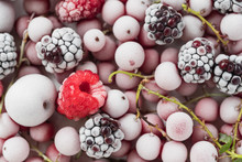 Frozen Berries On The White Pl...