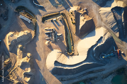 Obraz Quarry works industrial digging aerial view from above showing sand mound and hills - fototapety do salonu