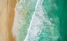 Aerial View Of Beach; Waves Rolling Toward The Shore