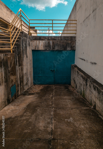a blue door on urban place - 330245317