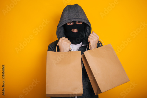 Thief with paper bags Canvas Print