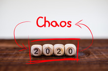 Inscription 2020 On Wooden Cubes And The Inscription CHAOS With Red Arrows, 2020 Crisis Concept