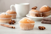 Tasty Muffins With Icing Sugar On A Wooden Kitchen Table Ready To Eat. Cinnamon Sticks And Star Anise. Sweet Dessert.